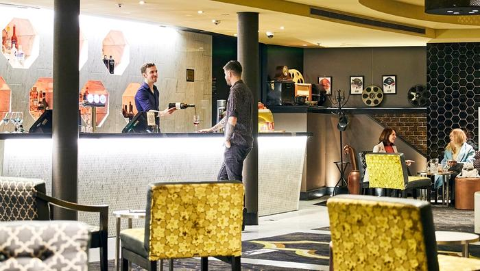 Bar interior with gold black and grey decor