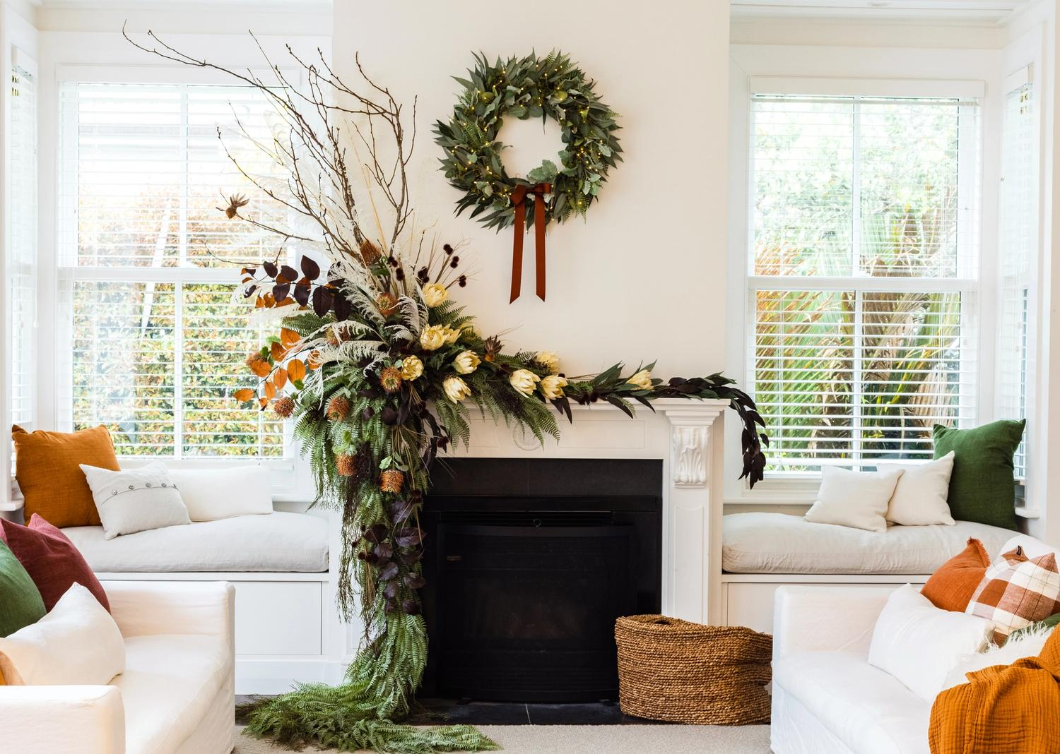 White lounge with Christmas wreath above fireplace