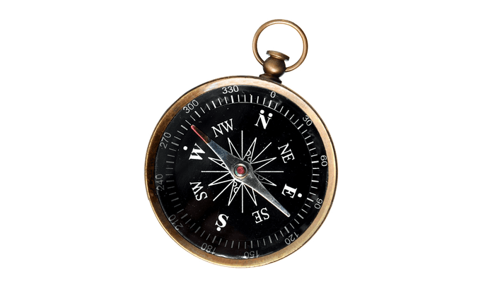 A black and gold compass on a white background