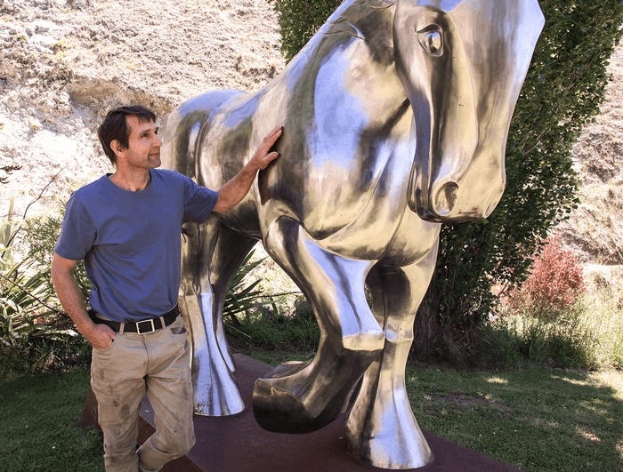 Raymond Herber with a silver horse statue at Iron Ridge Quarry