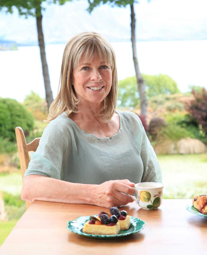 Annabel Langbein sitting at table drinking tea