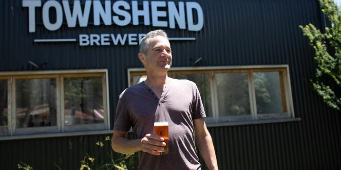 Martin Townshend holding beer
