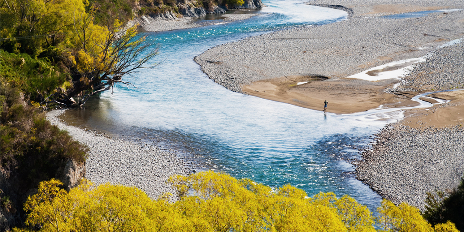Blue water stream running through countryside of Hurunui