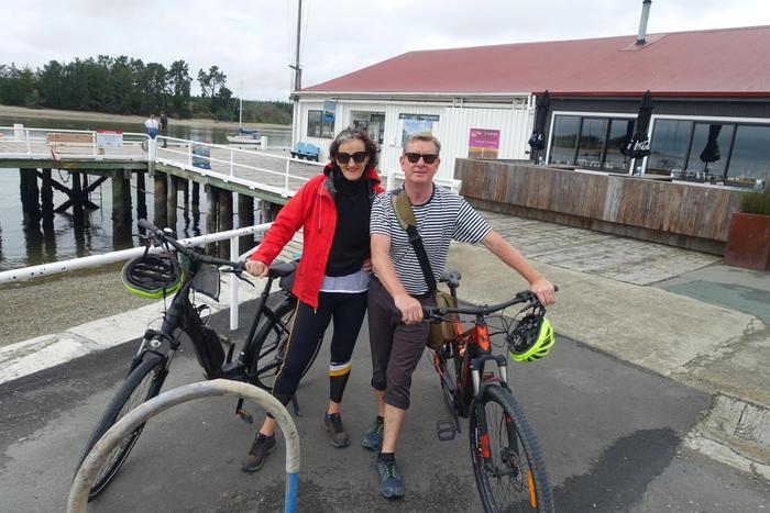 Sarah-Kate Lynch standing with friend each with a bike