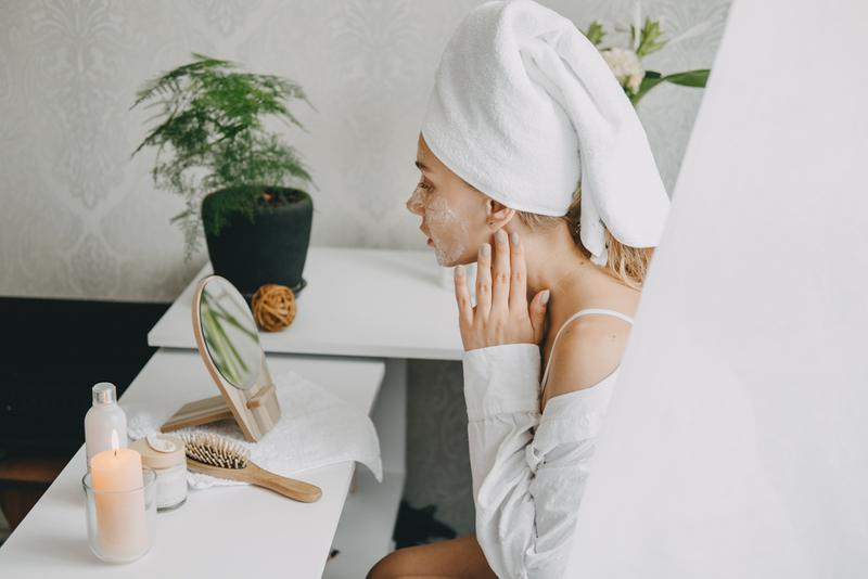 Women gently applying Most Wanted face oil serum for skin care routine