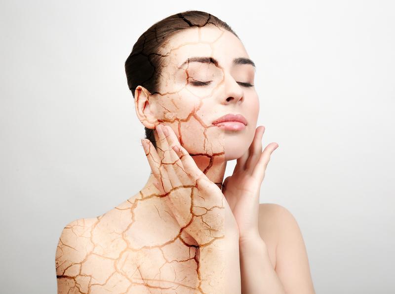 Woman applying Feelist facial oil serum to heal dry flaky skin