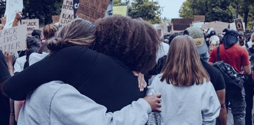 Black lives matter protesters embracing