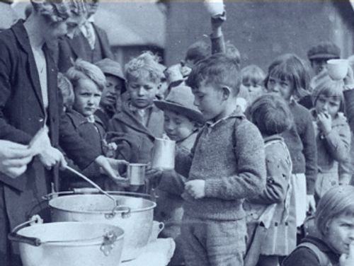 Children being served food during The Great Depression.