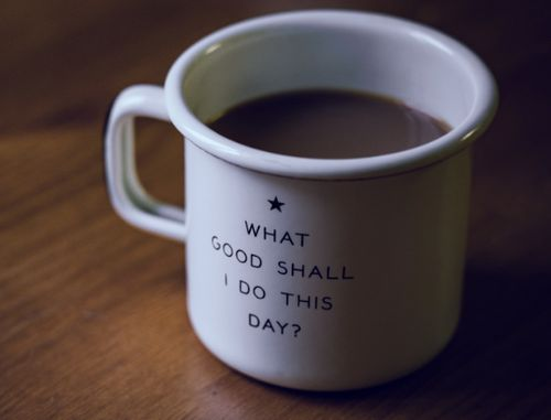 A cup of coffee with a message on the cup reading