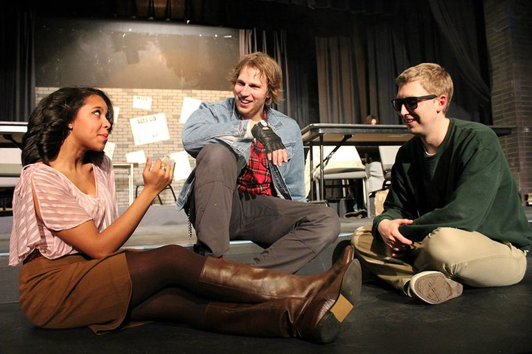 Claire, Bender, and Brian sit in a circle smoking and laughing in The Nerve's production of The Breakfast Club.