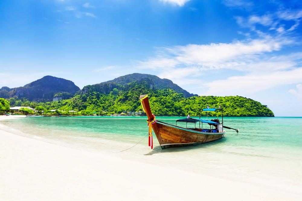 spiaggia con barca koh samui thailandia