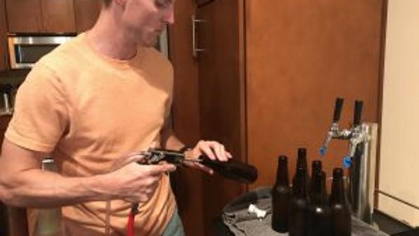 guy filling bottles