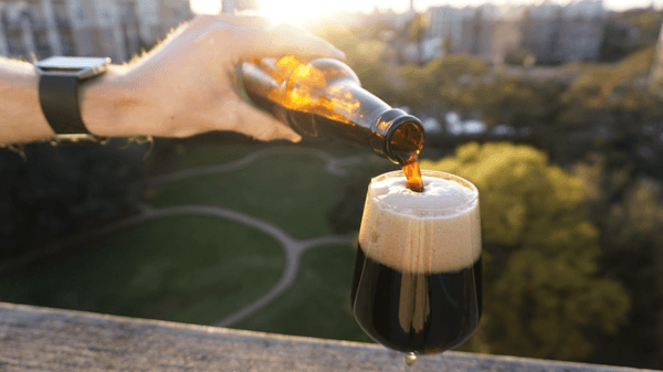 pouring beer in the sun