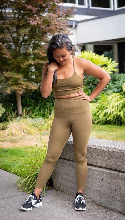 woman in beige gym gear
