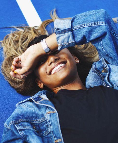 deodorant vs body spray, girl smiling