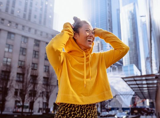 happy woman in yellow hoodie, the science of sweat