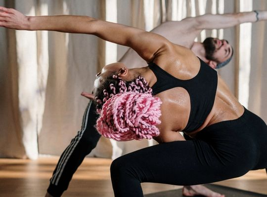 a man and a woman stretching, excessive backsweat
