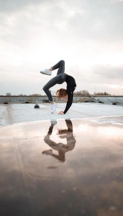 Woman in the middle of a back flip