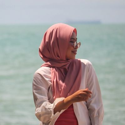 woman by the sea, helping to break barriers