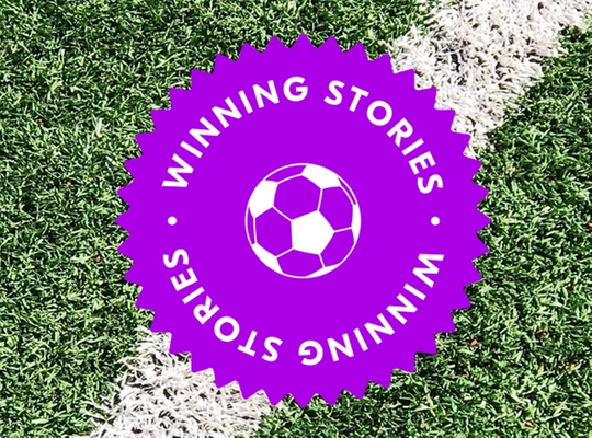 winning stories badge over a football pitch background