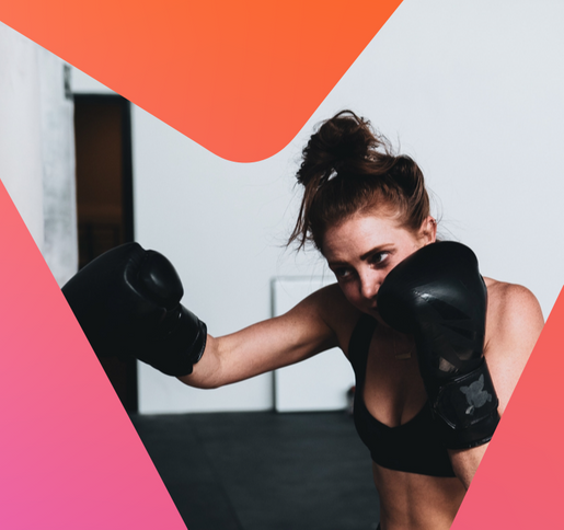 women shadow boxing with black boxing gloves