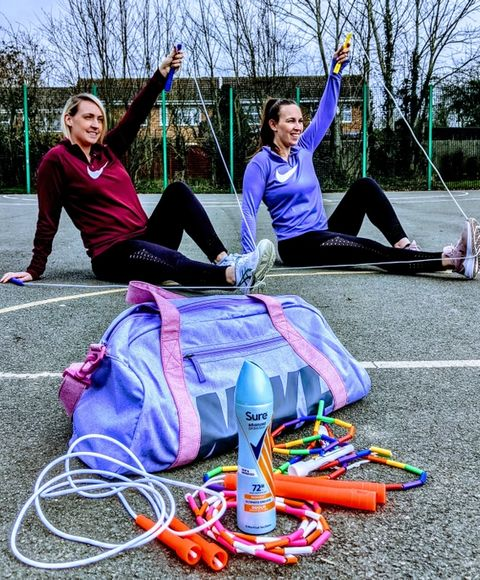 2 women sitting with skipping ropes