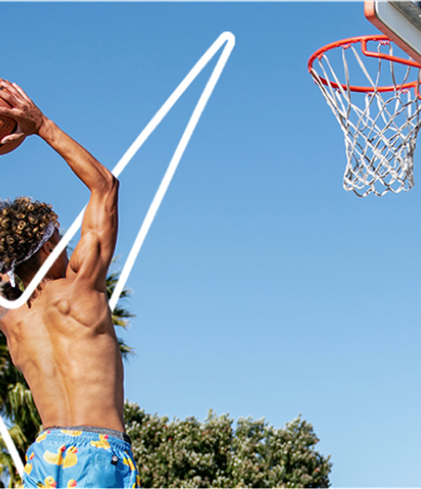topless man about to sink a hoop