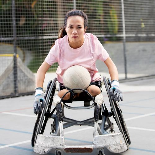 Ratni on a wheelchair with a ball on her lap