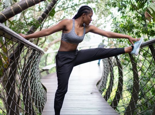 woman stretching outside on a walkway