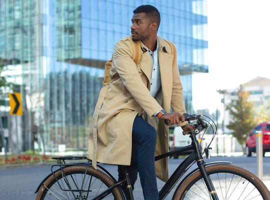 Man riding a bike in a city