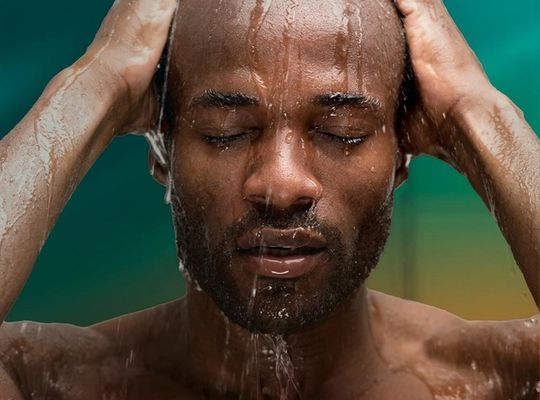 Man recovering after exercise in the shower