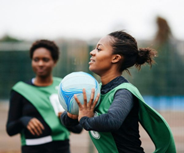 Korfball. Person holding a ball about to throw it