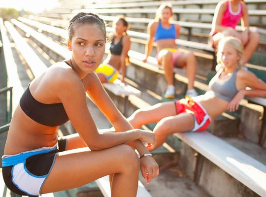 Group of young women athletes recovering after a workout