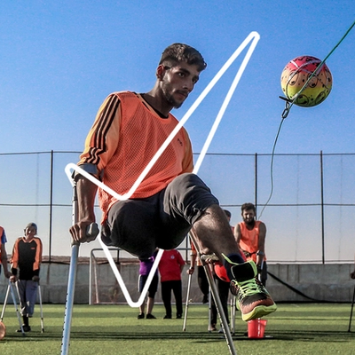 Young soccer player using crutches enjoys playing keep up