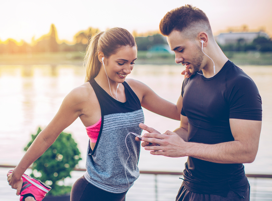 healthy young couple exercising in the sunshine