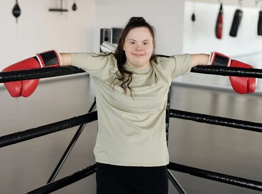 women standing in a boxing ring corner