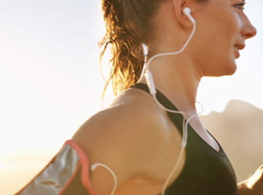 Lady running with earphones in.