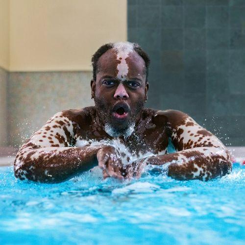 Bashir swimming in a pool