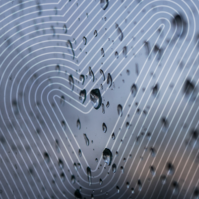 water droplets on glass with the sure tick over the top