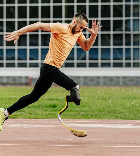 Paralympian sprinter training hard on the running track.