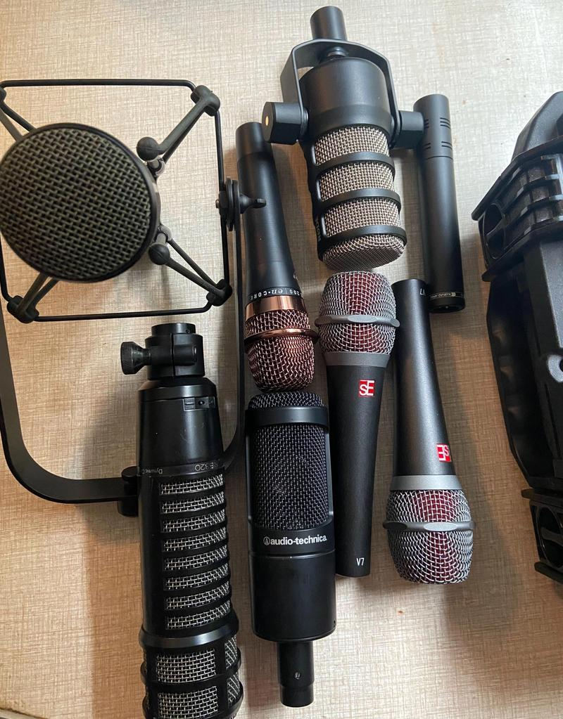 A collection of seven microphones I just had lying on my desk at home.