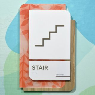 Sign on wall indicating stairs