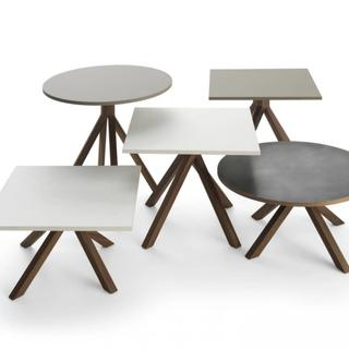 Several side tables with wood bases and various tops