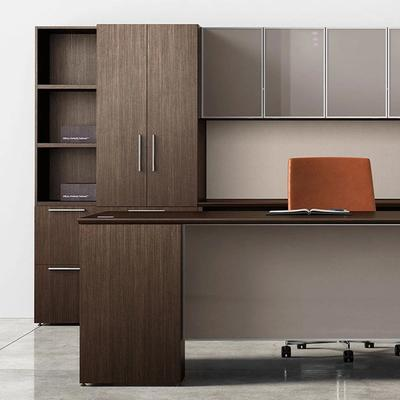 Brown executive desk with orange chair and cabinets