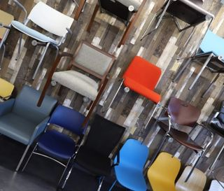 Wall full of colorful chairs