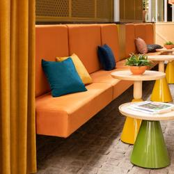 Orange booth with blue and yellow pillos