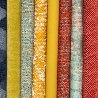 A collection of different colors and patterns of textile fabrics