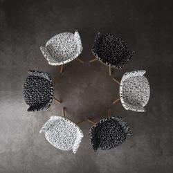 Chairs with black and white patterned fabrics in circle