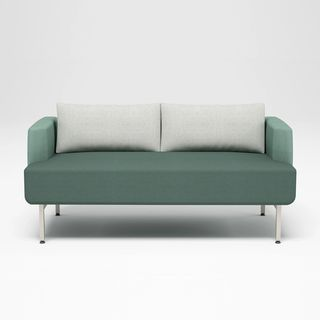 Green booth with white back pillows