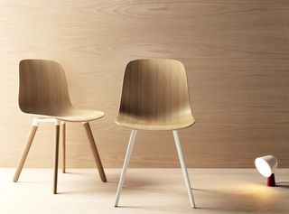 Stylex wooden chairs with light pointing at ground